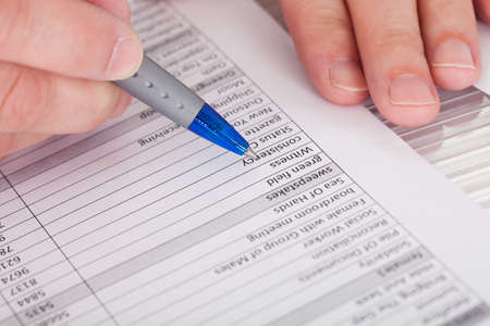 Close-up Photo Of Person Filling Application Form photo