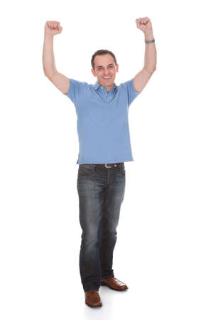 Happy Man With Arm Raised Over White Background Stock Photo - 20510692