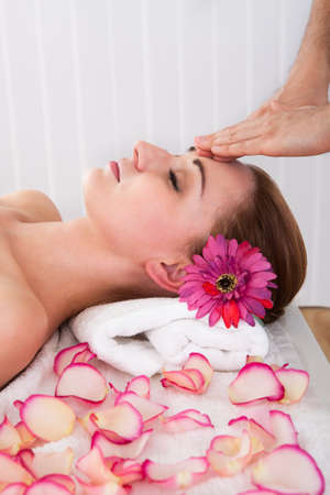 eye massage: Woman getting treatment in the spa centre