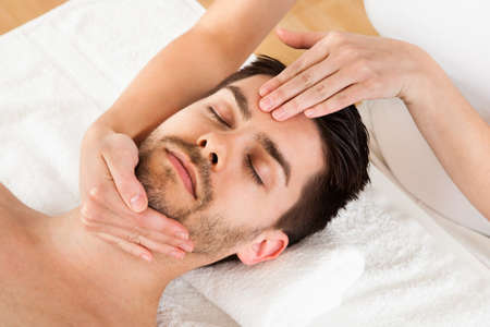 chiropractic: Man getting massage in the spa centre