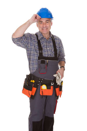 jumpsuit: Mature Man Holding Wrench Over White Background