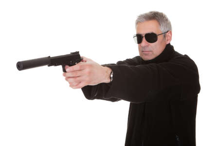 silencer: Mature Man Over White Background Aiming With Handgun