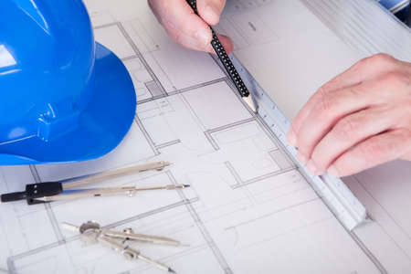 Portrait Of Mature Architect Male With Blueprint In The Office Stock Photo - 20509278