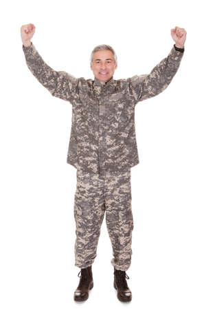 raised arms: Mature Soldier Raising His Arm Isolated On White Background Stock Photo