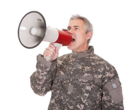 bellowing: Mature Soldier Shouting Through Megaphone Isolated On White Background