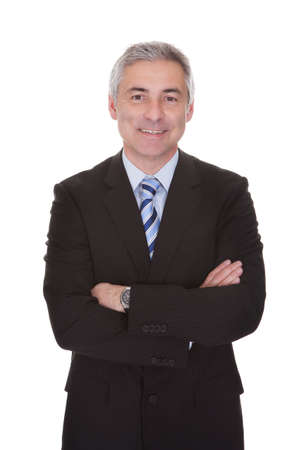 man arm: Portrait Of Mature Businessman Isolated Over White Background
