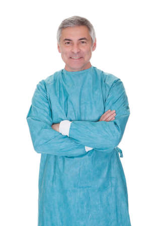 Portrait Of Mature Male Surgeon Isolated Over White Background photo