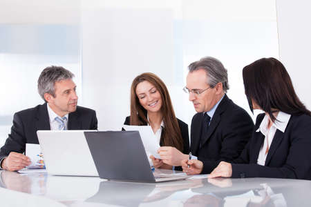 senior business: Portrait Of Happy Business People Working Together Stock Photo