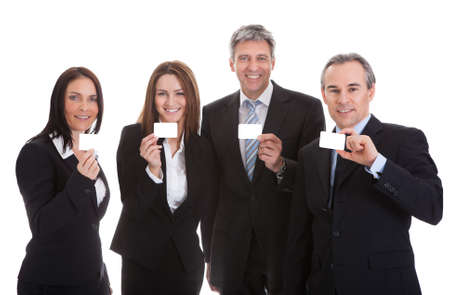 Happy Businesspeople Holding Visiting Card Over White Background Stock Photo - 20543687