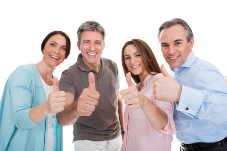 thumbs up gesture: Group Of Happy People Showing Thumb Up Sign Over White Background