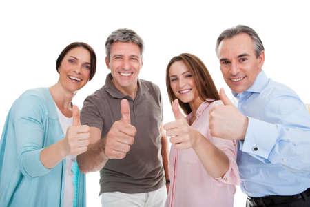 thumbs up group: Gruppo di persone felici che mostra pollice in alto segno su sfondo bianco Archivio Fotografico