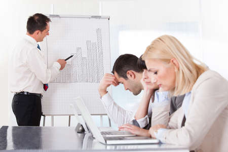 portable failure: Frustrated Employees In The Office Business Meeting Stock Photo