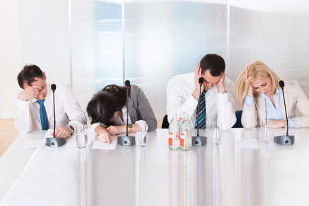 unmotivated: Bored Business People In The Conference Meeting