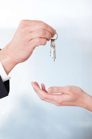 Consultant Giving Keys To Woman In Office photo