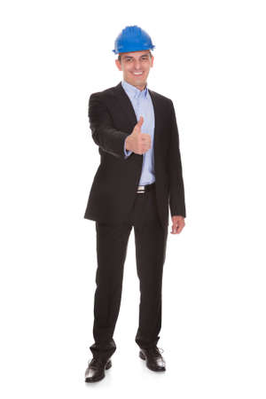 Happy Male Architect Showing Thumbs-up Sign Over White Background Stock Photo - 20615303