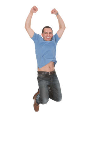 Happy Man With Arm Raised Over White Background Stock Photo - 20615304