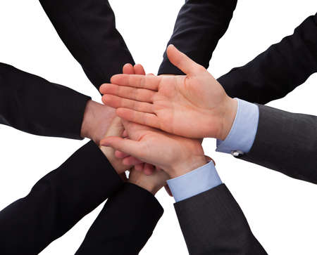 loaning: Group Of Businesspeople Hands Over White Background