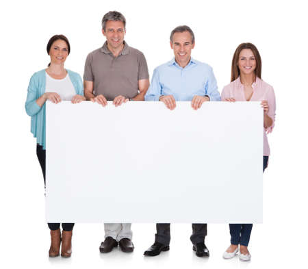 Group Of Happy People Holding Placard Over White Background photo