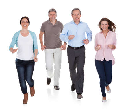Portrait Of Happy People Running On White Background photo