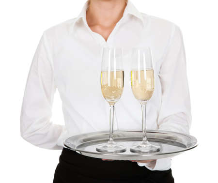 Close-up Of Waitress Carrying A Tray With Wine Glasses Over White Background photo
