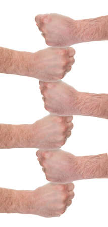 clenching fists: Close-up Of Human Fist Stacking On Each Other Over White Background Stock Photo