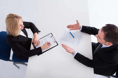 customer relationship: Happy Businessman And Businesswoman Discussing In Office