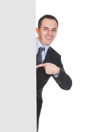 Happy Businessman Holding Placard Over White Background