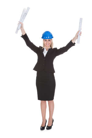 Portrait Of Excited Female Architect Holding Blueprint Over White Background Stock Photo - 20789400