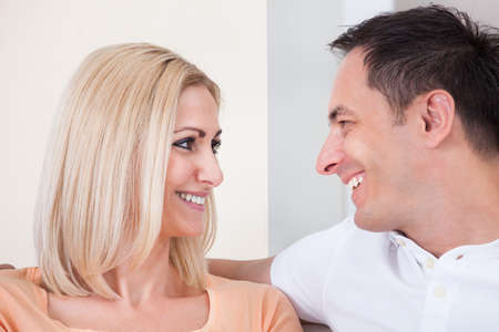 rubbing noses: Portrait Of Mid-adult Happy Couple Smiling Together