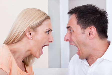 arguments: Portrait of angry couple shouting at each other Stock Photo