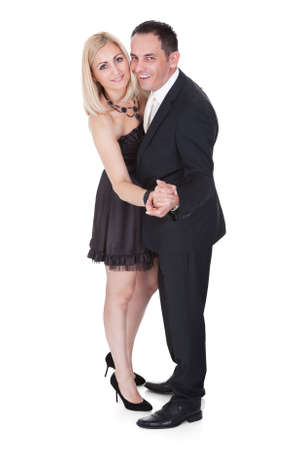 Couple Dressed In Formal Attire Dancing Isolated Over White Background photo