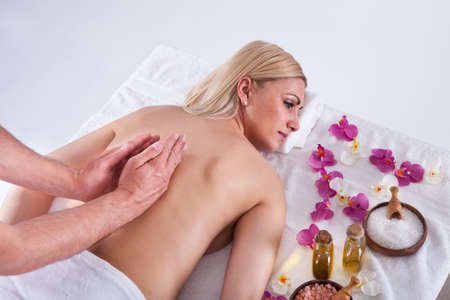 body oil: Beautiful Young Woman Getting Message At Spa Salon