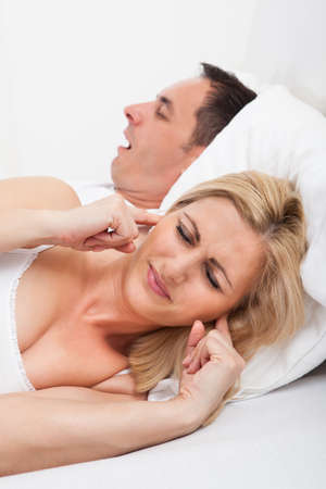 Portrait Of An Angry Woman Awaken By Her Boyfriend's Snoring photo