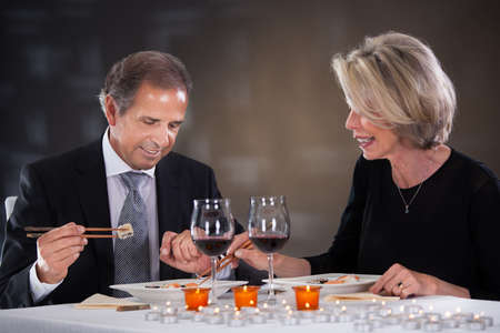 Happy Mature Couple Enjoying A Sushi In A Restaurant photo