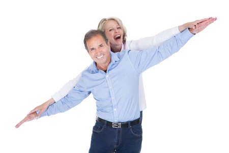 extending: Happy Mature Couple Extending Their Hand Isolated Over White Background