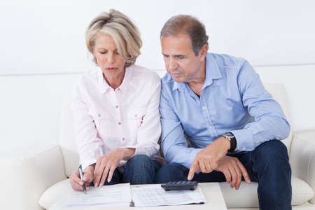 retirement home: Mature couple doing family finances at home