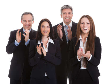 Portrait Of Happy Businesspeople Clapping Over White Background photo