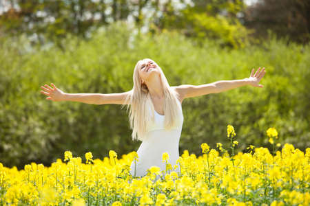 rape: Smiling Relaxed Young Woman Amid With Flowers In Field