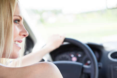odometer: Close-up Of Womans Hand Holding Steering Wheel Stock Photo