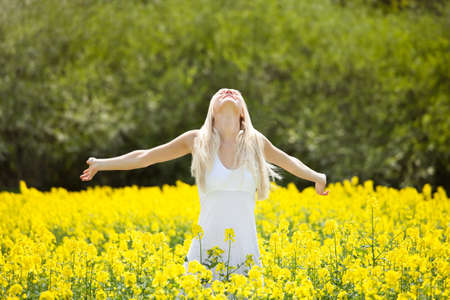 adult rape: Smiling Relaxed Young Woman Amid With Flowers In Field