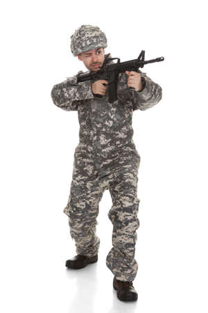 man holding gun: Young Soldier Aiming With Gun Over White Background