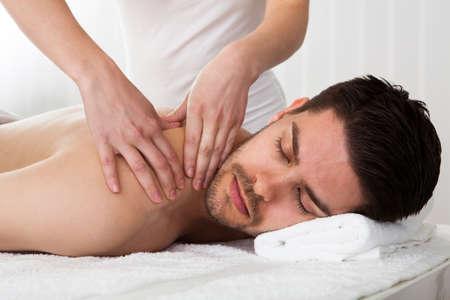 Massage: Человек получает массаж в спа-центре Фото со стока