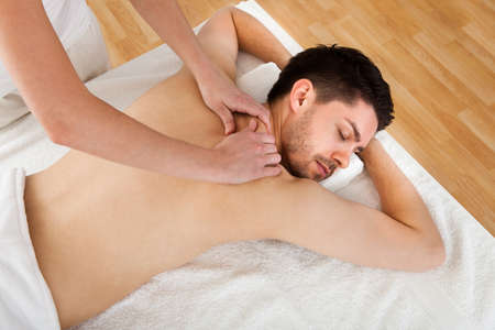 eye massage: Man getting massage in the spa centre