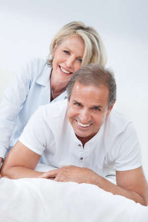 Portrait Of Happy Senior Couple Together In Bed photo