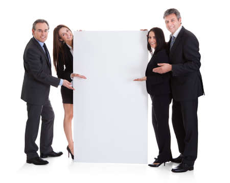 placard: Happy Business People Showing Placard Over White Background