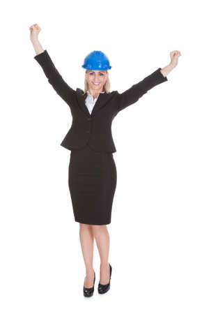 Portrait Of Excited Female Architect Holding Blueprint Over White Background Stock Photo - 20983623