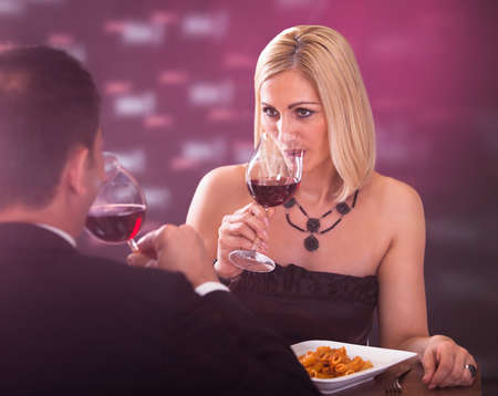 Happy Beautiful Couple Enjoying Meal And Wine In Restaurant Stock Photo - 20977974