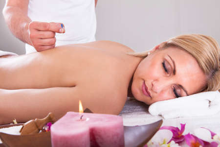 wellness center: Young Beautiful Woman In An Acupuncture Therapy In A Spa Center Stock Photo