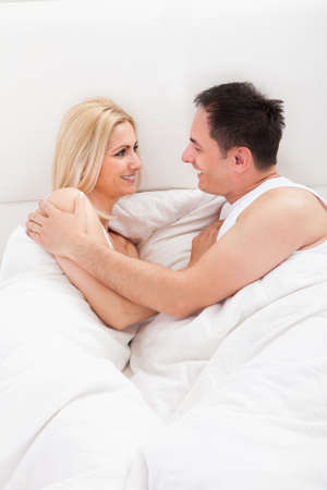 bed sheets: Portrait Of Lovers Embracing Each Other In Bed