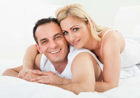 Portrait Of Mid-adult Happy Couple Smiling Together photo